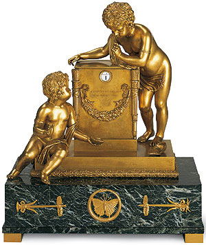 Picture: Bronze gilded mantel clock